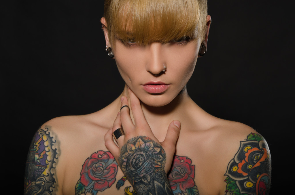 Beautiful blonde with a tattoo on body